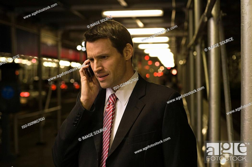 Stock Photo: Businessman using a cellular telephone.