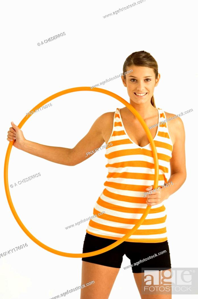 Stock Photo: Portrait of a young woman holding a plastic hoop.