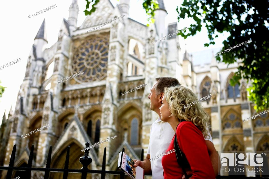 Stock Photo: A middle-aged couple looking at Westminster Abbey, London.