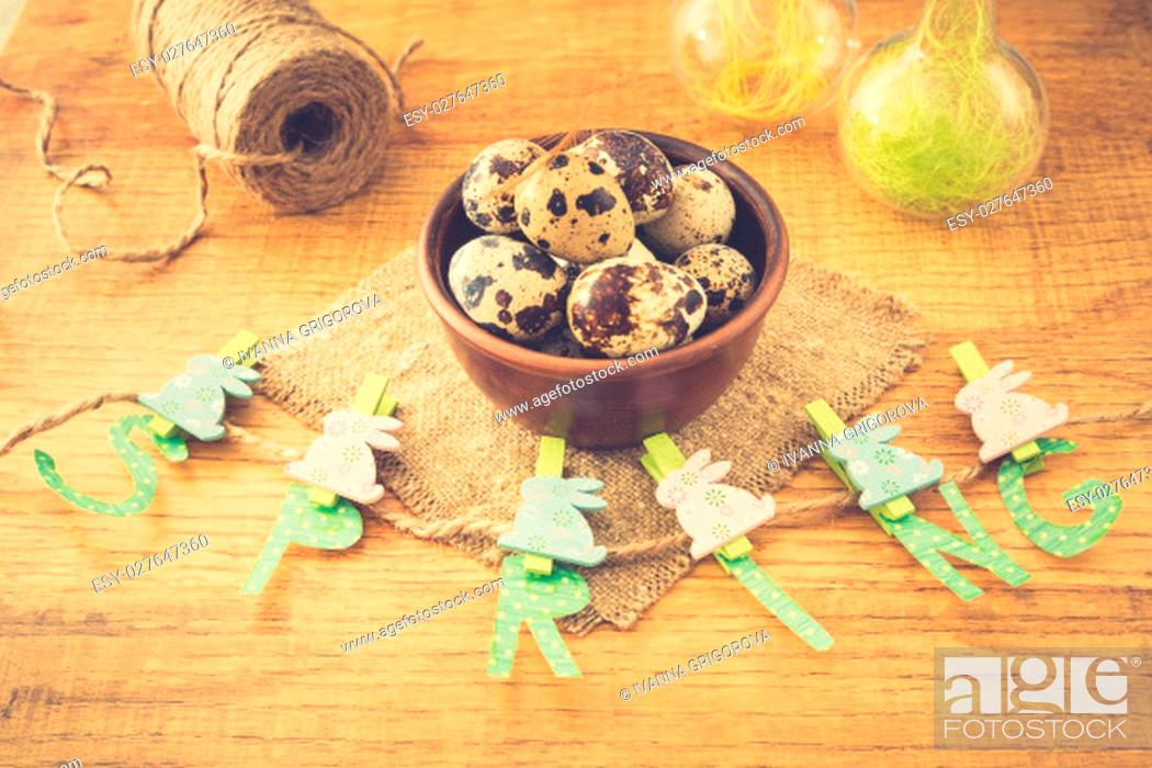 Stock Photo: Spring and Easter composition with quail eggs on wooden table.