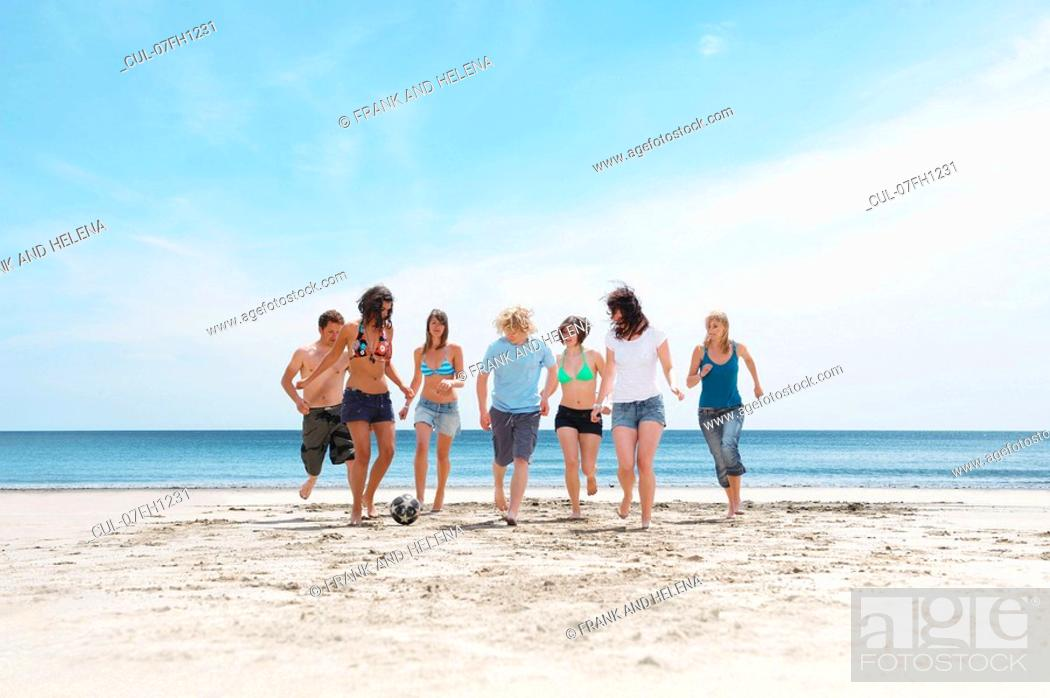 Stock Photo: Group playing with ball on beach.