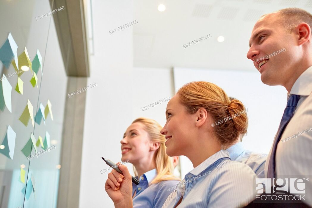 Stock Photo: business, people, teamwork and planning concept - smiling business team with marker and stickers working in office.