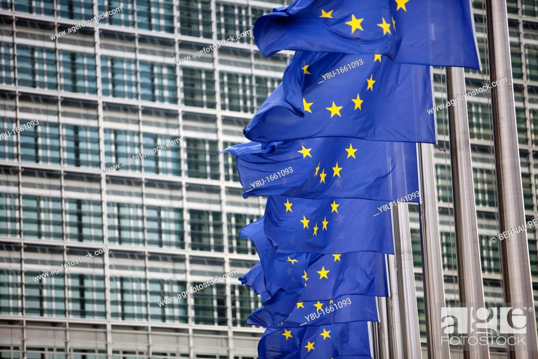 Stock Photo: European flags wave next to the European Commission headquarters in Brussels, Belgium.