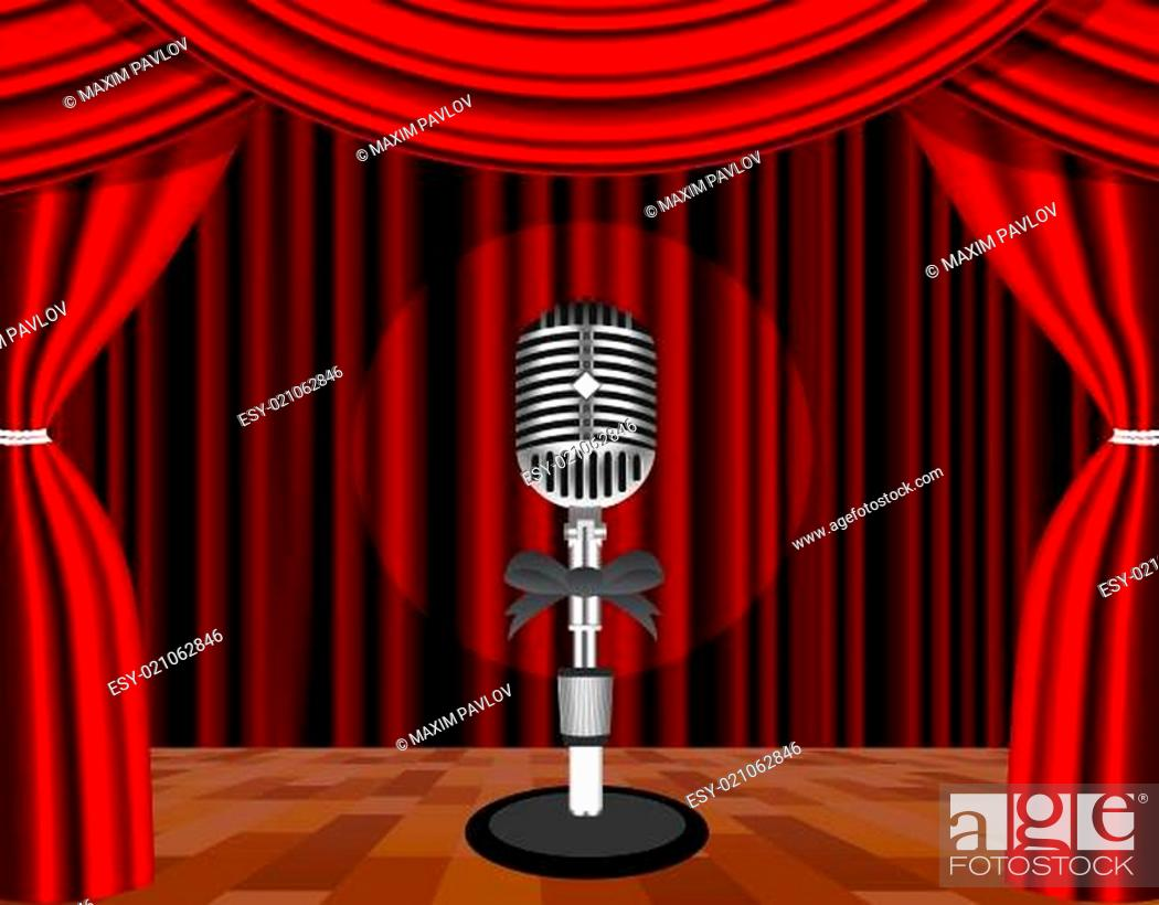 Stock Photo: A microphone on a stage with a spotlight on it.