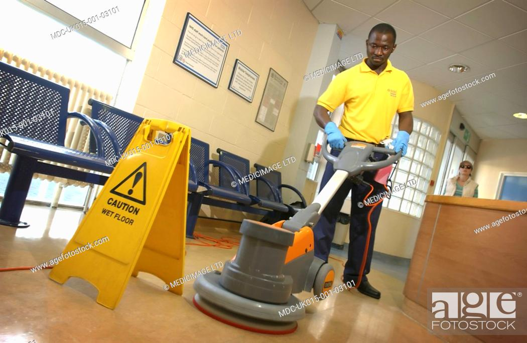 Imagen: A Rentokill Initial Hospital Services employee polishing the waiting room floor.