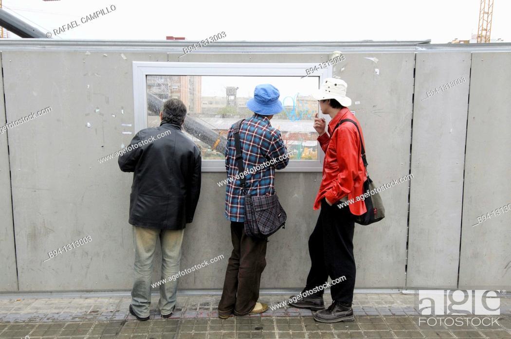 Stock Photo: People looking at construction site, Plaça de les Glories, Barcelona, Catalonia, Spain.