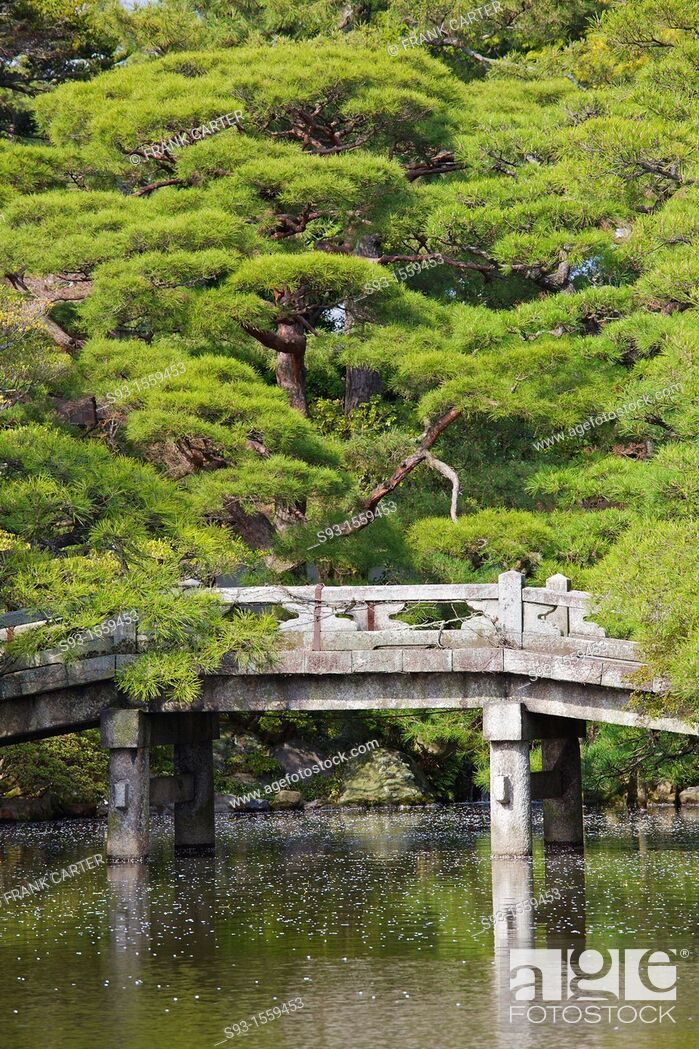 Stock Photo: A stone arched Japanese bridge in a garden inside the Imperial Palace.