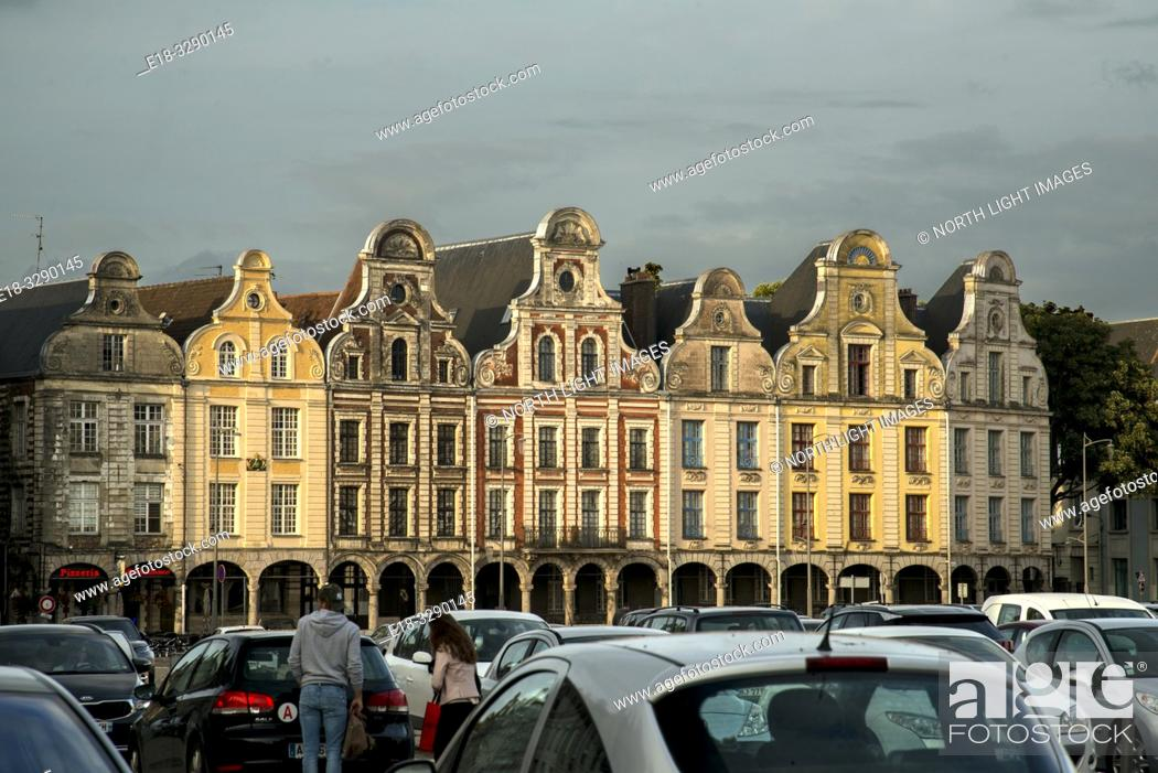 Stock Photo: France, Arras. Cars parked in the Town Square surrounded by a unique architectural collection of Flemish-Baroque-style townhouses.