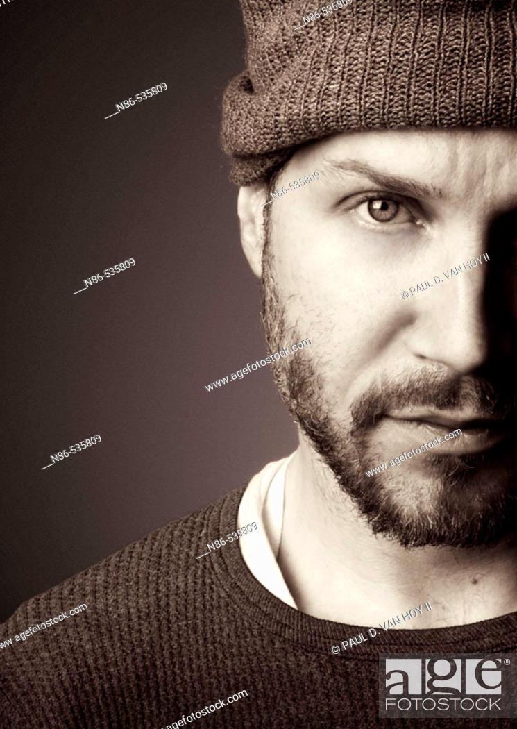 Stock Photo: Scruffy man in hat, fashion.