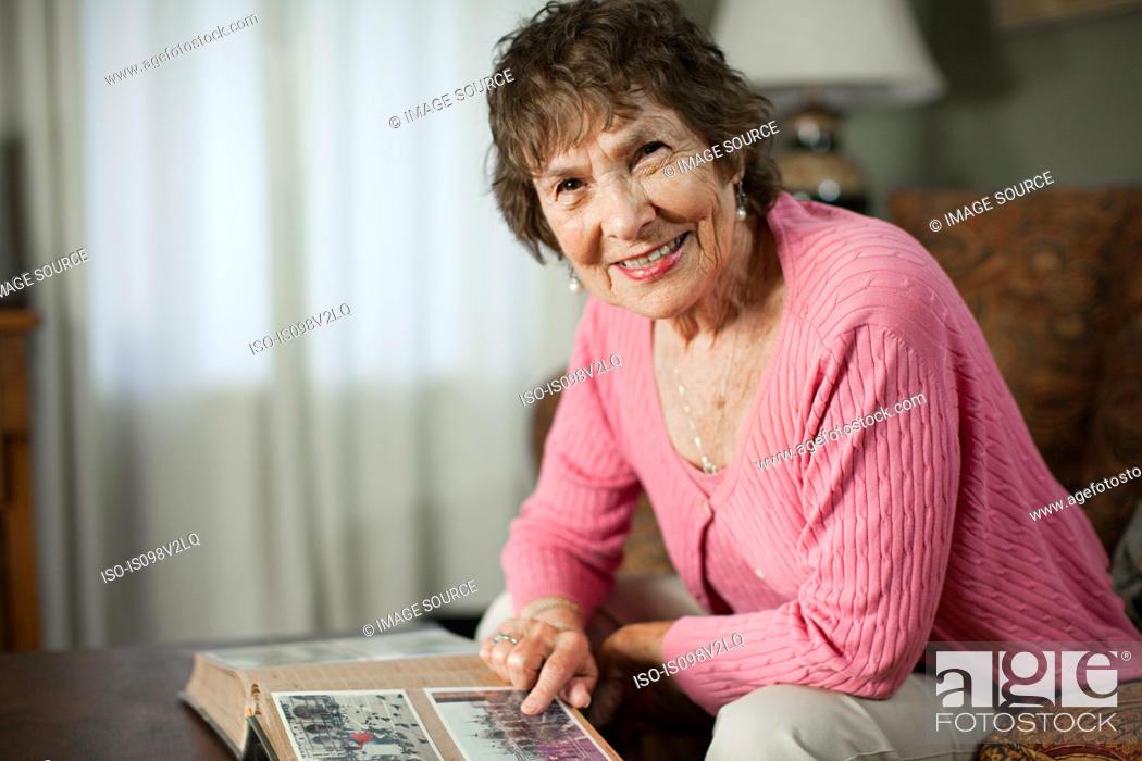Stock Photo: Senior woman with family album.