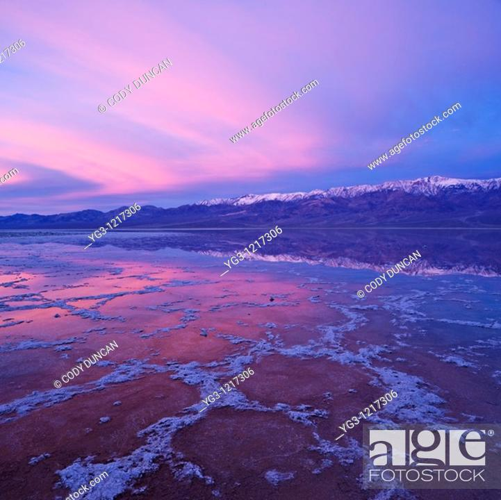 Stock Photo: Sunrise reflection in Badwater Basin and Panamint mountains, Death Valley national park, California.