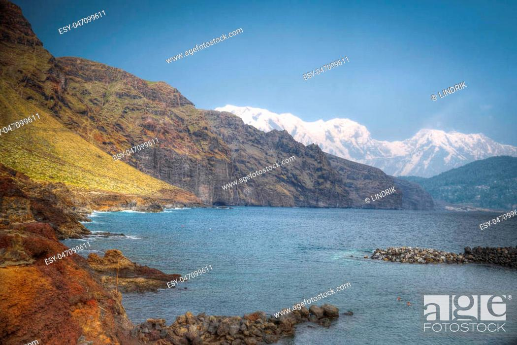 Stock Photo: View of the bay against the backdrop of snow-capped peaks of the mountains.