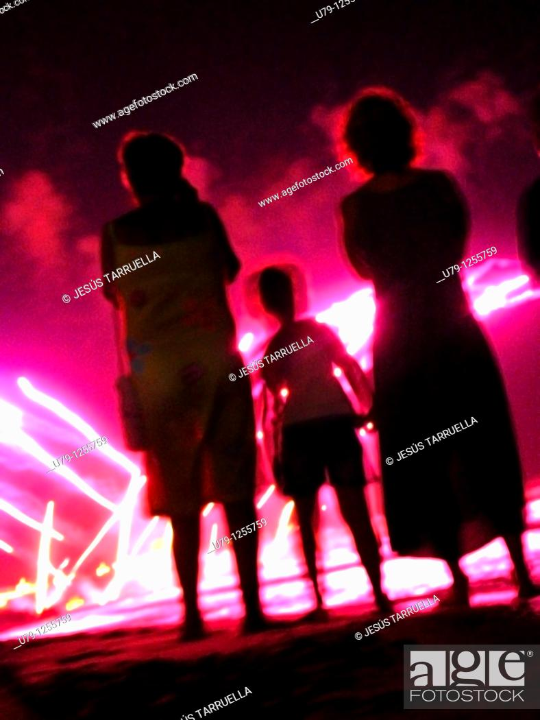 Stock Photo: People in a fireworks show.