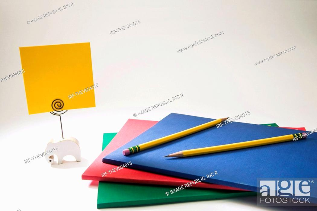 Stock Photo: pencils on the pile of notes and memo holder.