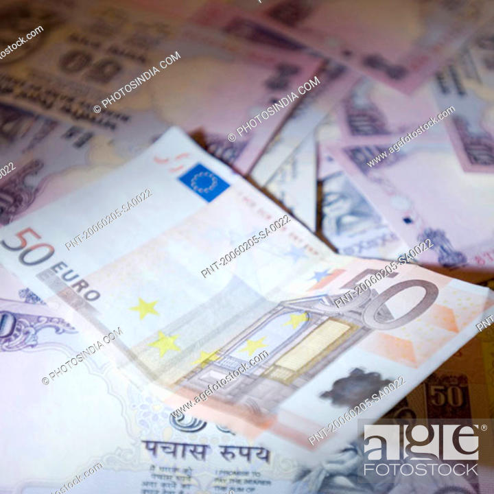 Stock Photo: High angle view of a fifty Euro banknote and Indian banknotes.