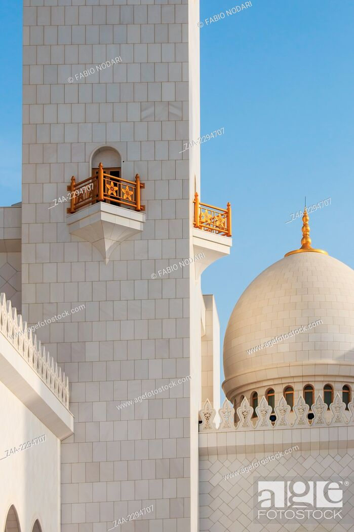 Stock Photo: Domes of the Sheikh Zayed Grand Mosque at sunset.