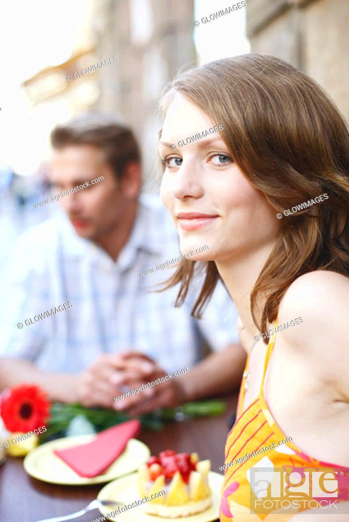 Stock Photo: Portrait of a teenage girl seated at a table in a restaurant.