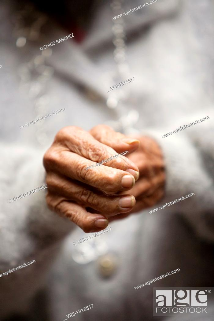 Stock Photo: The hands of an elderly woman in the Our Lady of Guadalupe Home for the Elderly, Mexico City, December 13, 2010.