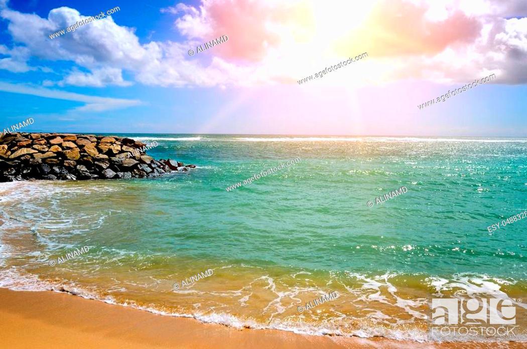 Stock Photo: Sea landscape with rocky island and the sunrise. Beach. Sri Lanka.