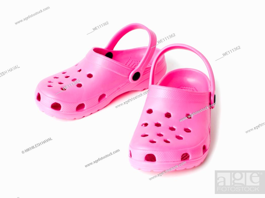 Stock Photo: Pink crocs sandals.