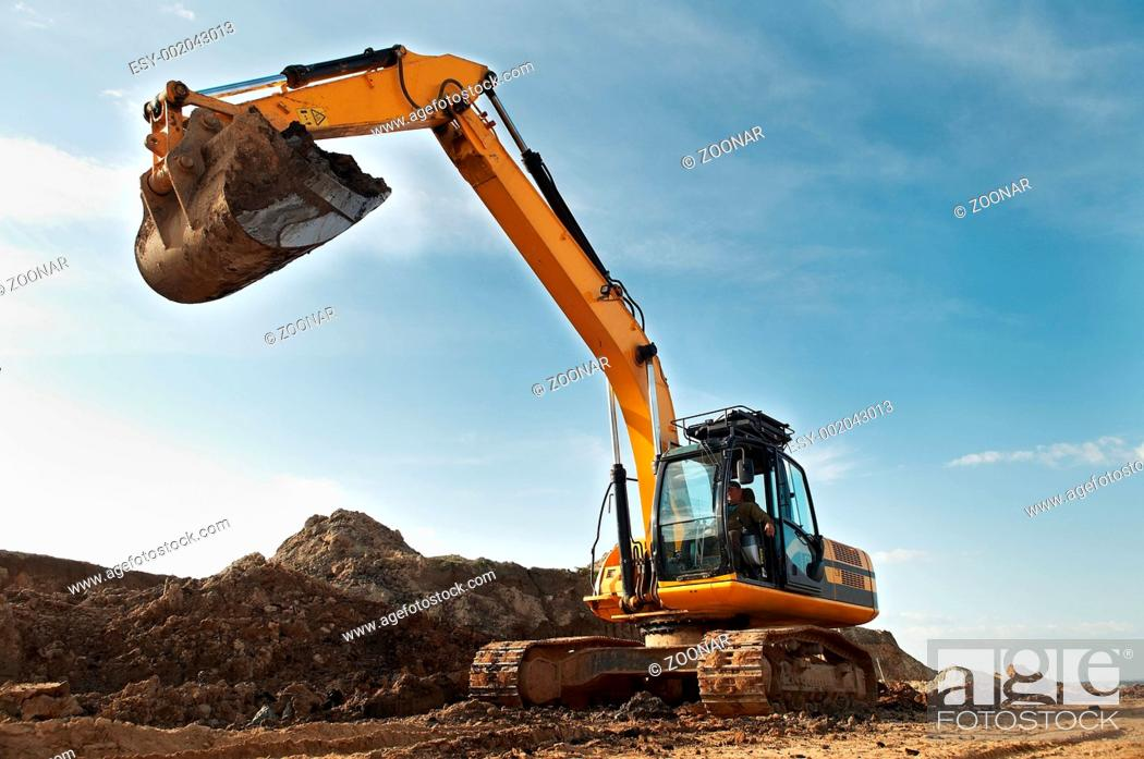 Stock Photo: Excavator loader in construction sandpit area.