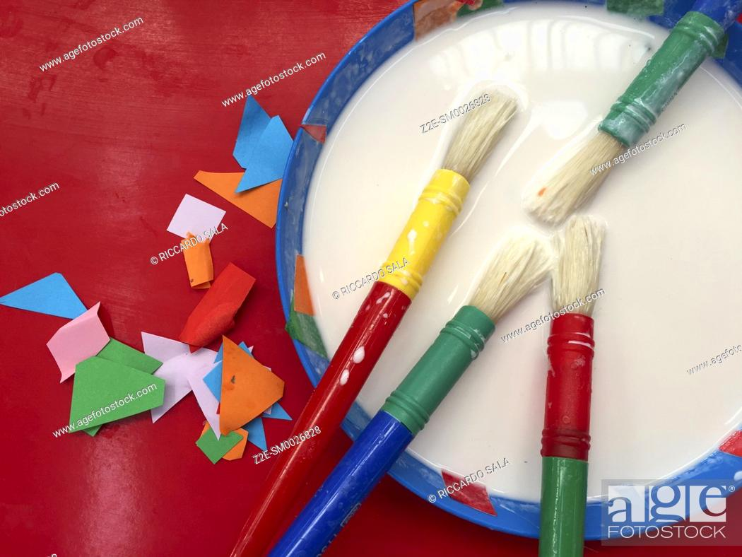 Stock Photo: Children Toy, Glue with Brush on Paper . . . .