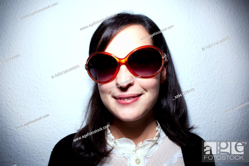 Stock Photo: Girl with sunglassess looking at camera.