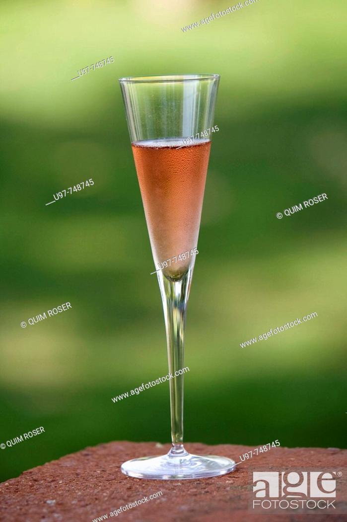 Stock Photo: Glass of 'cava', Catalan pink sparkling wine.