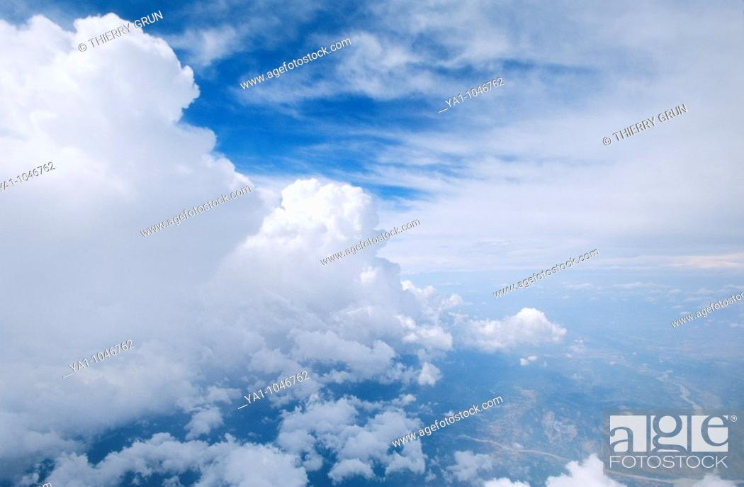Stock Photo: Aerial view off a front of congestus clouds. These kind of clouds are the step of formation cloud beetween Cumulus cloud and Cumulonimbus cloud.