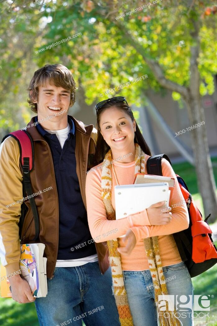Stock Photo: Portrait of two smiling college students outdoors.