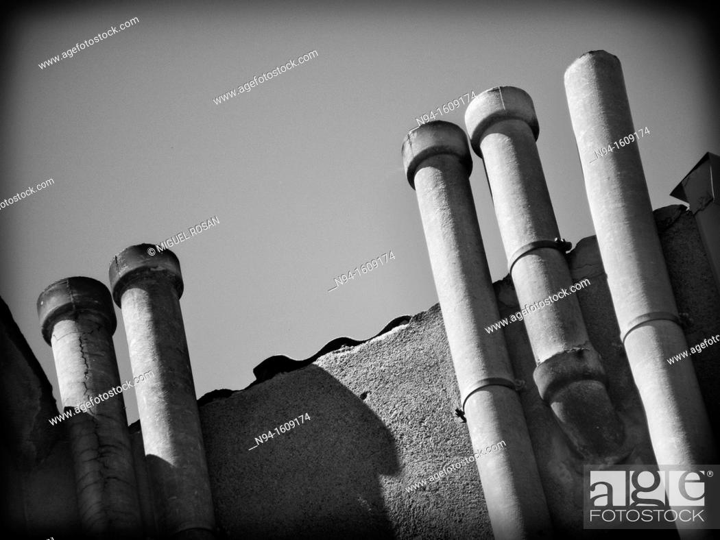 Stock Photo: Prefabricated chimneys smoke evacuation in the back of an apartment building.