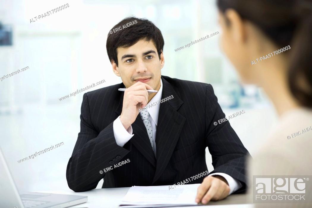 Stock Photo: Businessman listening carefully to client.
