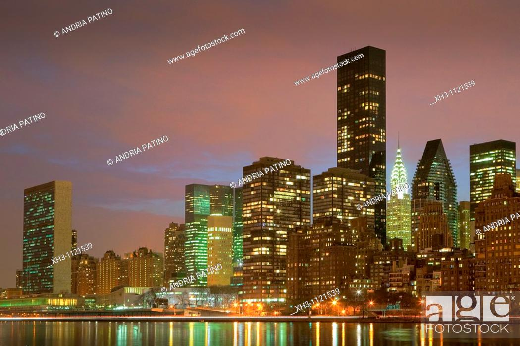 Stock Photo: The U N  and the Chrysler Buildings within the NYC skyline from the East River.