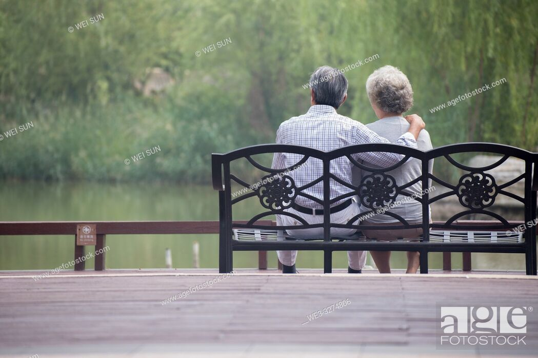 Stock Photo: Elderly couple outdoors, sitting on bench.