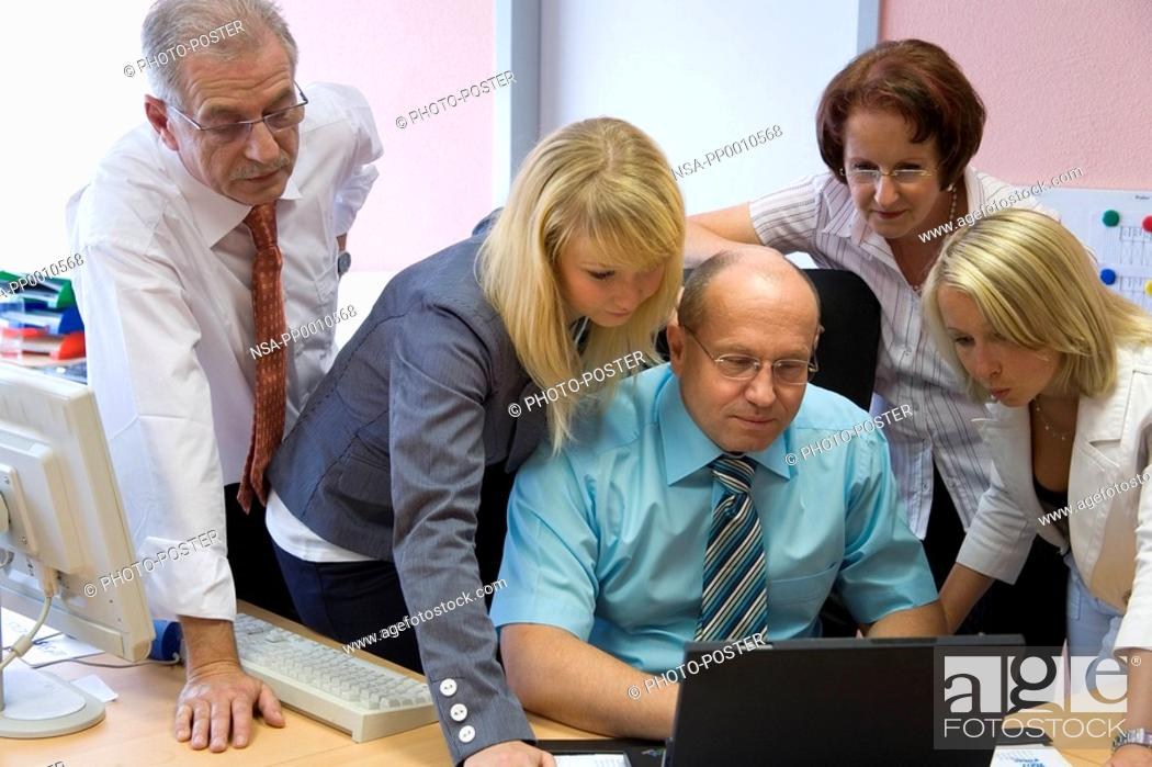Stock Photo: chief and his team looking all together at the monitor.