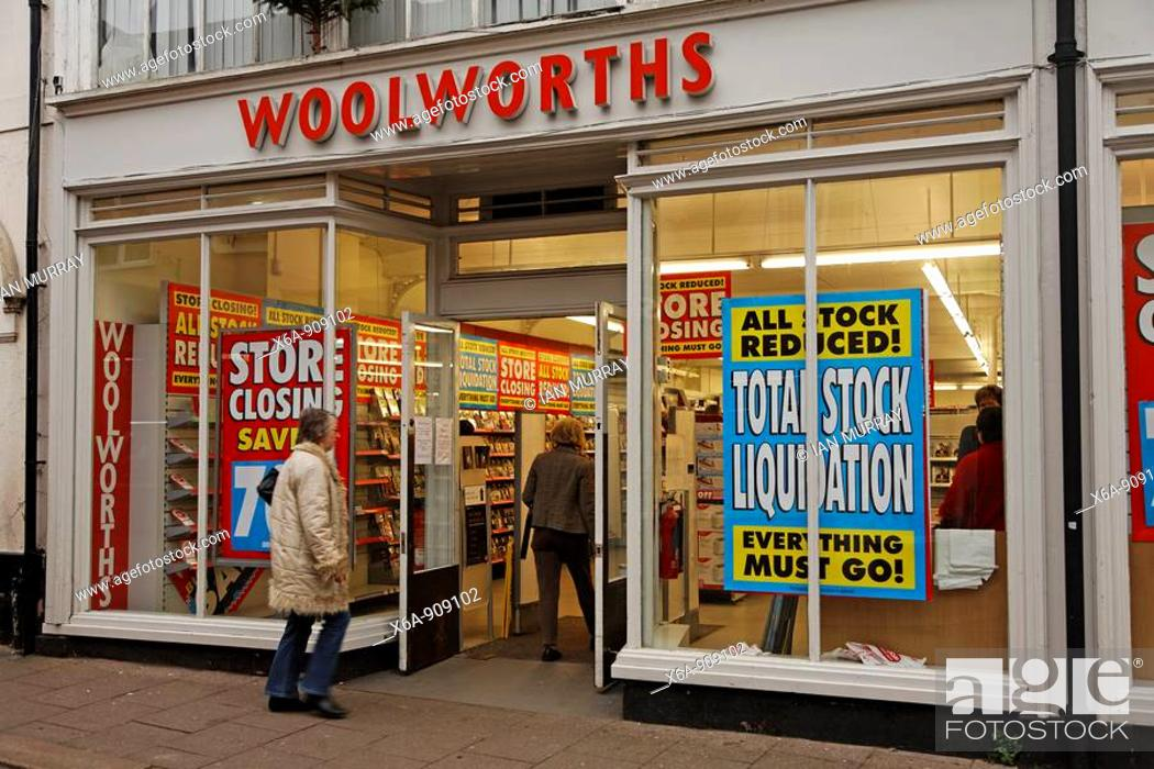 stock photo woolworths shop with stock clearance closure sales notices on christmas eve - Christmas Eve Sales