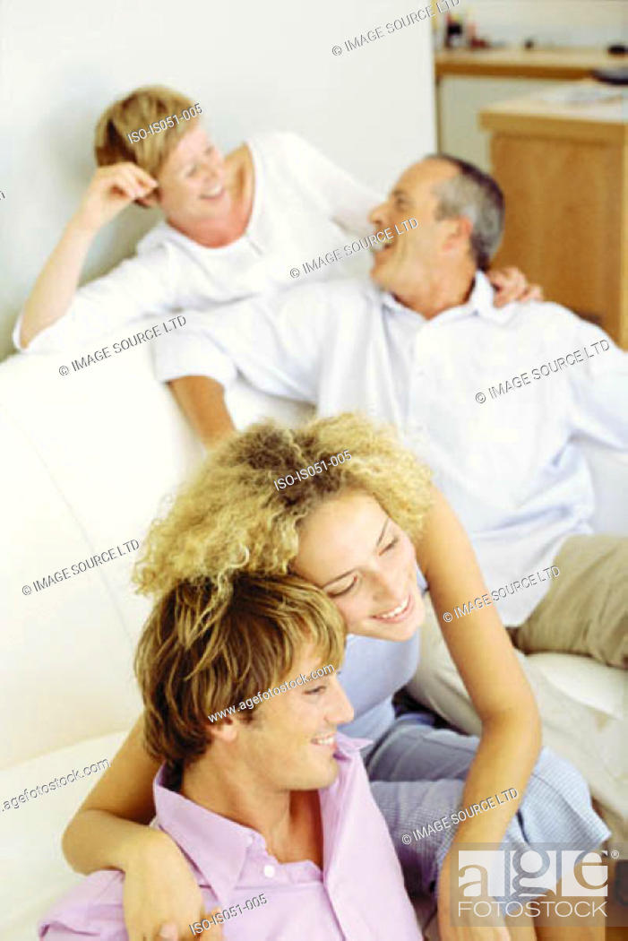 Stock Photo: Young couple with in-laws.