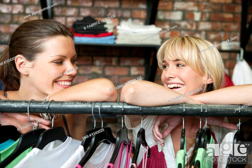Stock Photo: Two women shopping in a boutique.