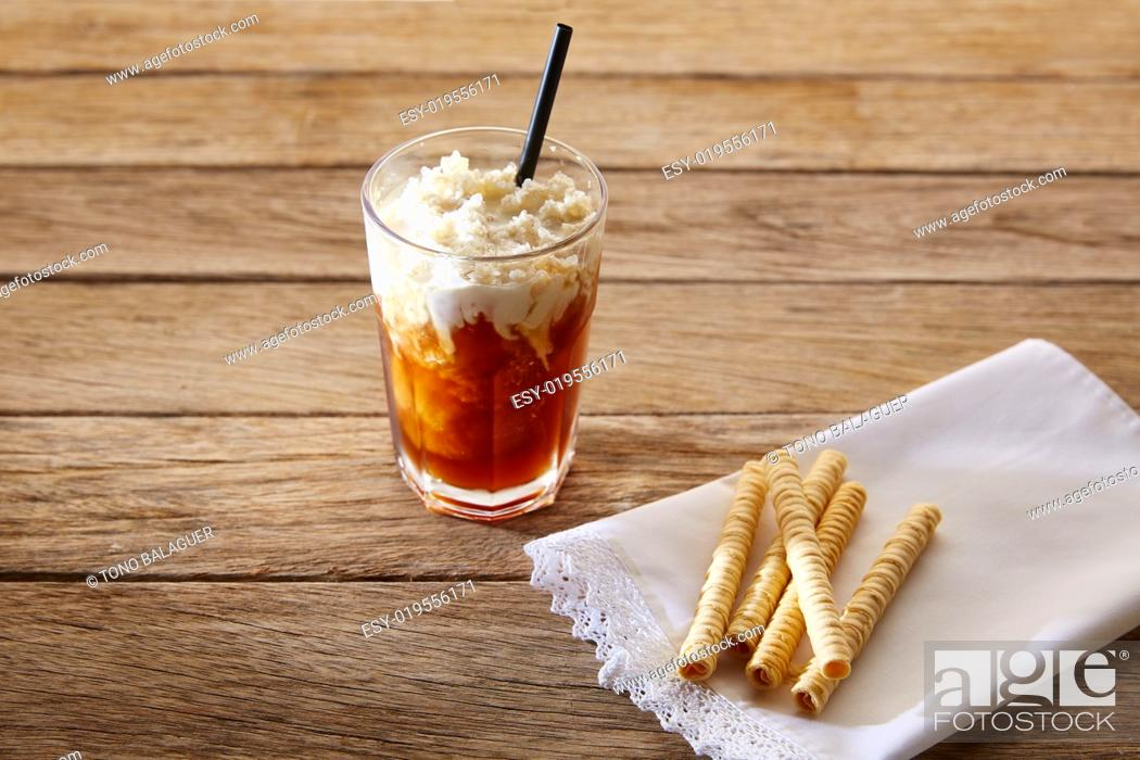 Stock Photo: Coffee smoothie with wafers on vintage wood table.