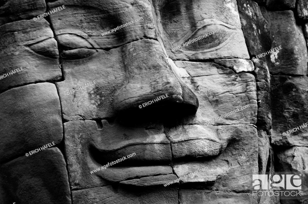 Stock Photo: Face of the Lokeshwaram at Angkor Thom.