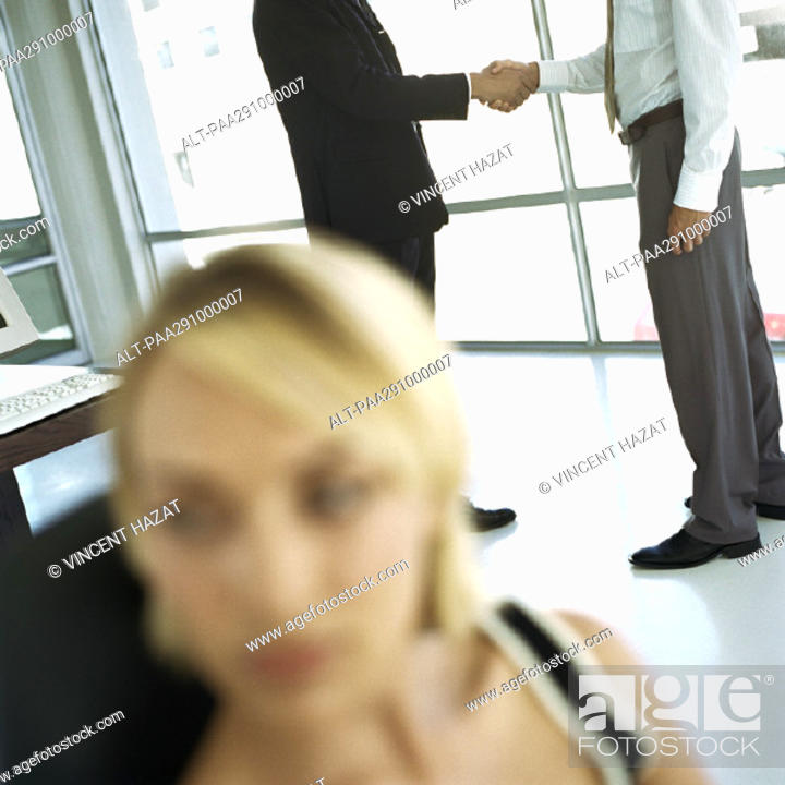 Stock Photo: Businessmen shaking hands in office.