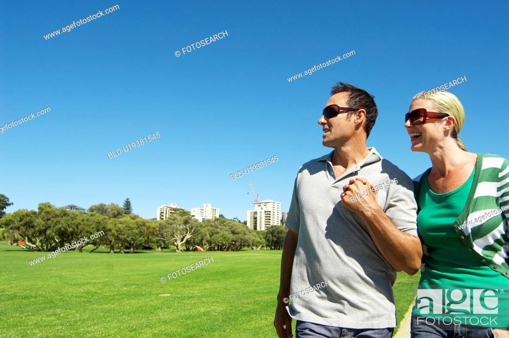Stock Photo: Mature couple looking at view in park.