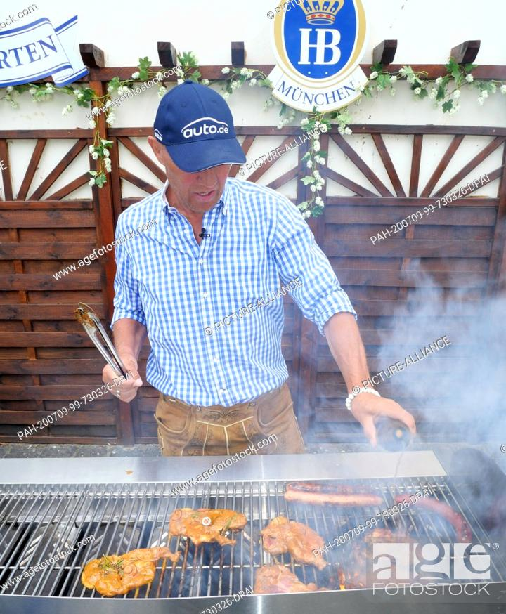 Stock Photo: 30 June 2020, Berlin: Ex-boxer and grill master Axel Schulz at the barbecue recorded on 30.06.2020 in the beer garden of the Hofbräu Inn at Alexanderplatz in.