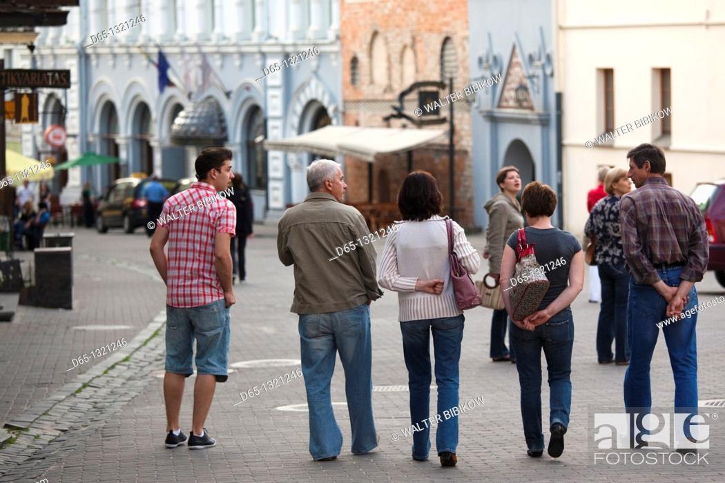 Stock Photo: Lithuania, Vilnius, Old Town, people on Ausros Vartu Street, NR.