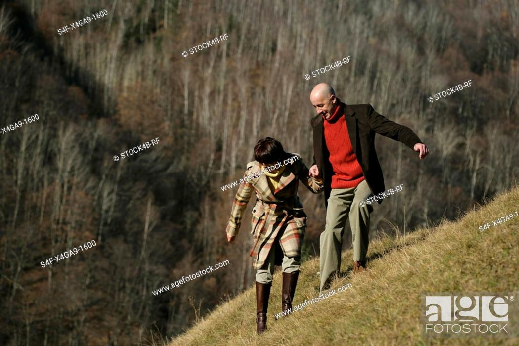 Stock Photo: Couple on a mountainside.
