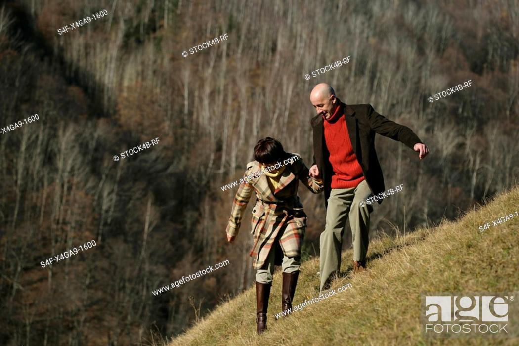 Stock Photo: Couple on a mountainside.