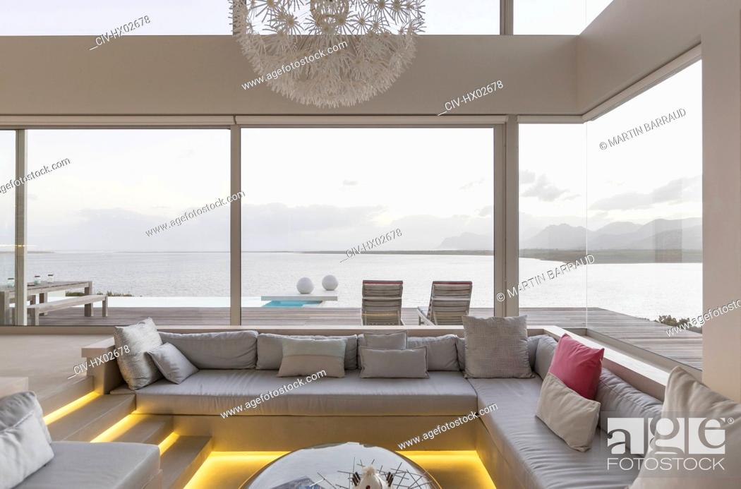 Stock Photo: Modern luxury home showcase interior living room with ocean view.