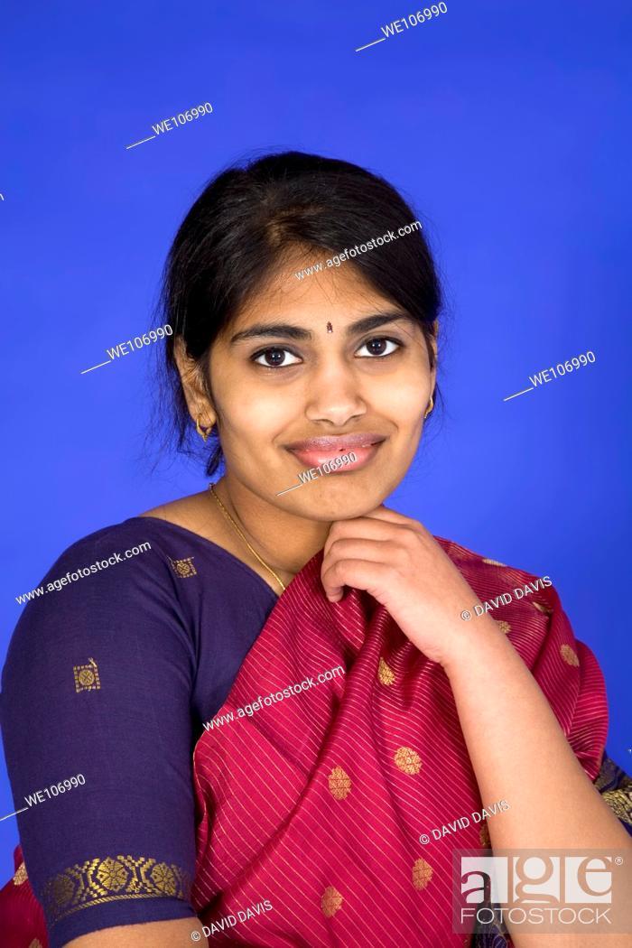 Stock Photo: Beautiful Hindu teenager dressed in a traditional Sari dress.