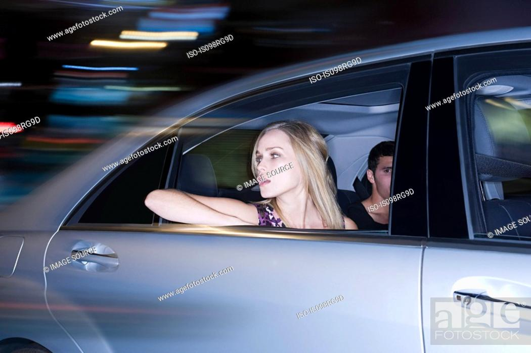 Stock Photo: Couple travelling in a speeding car.