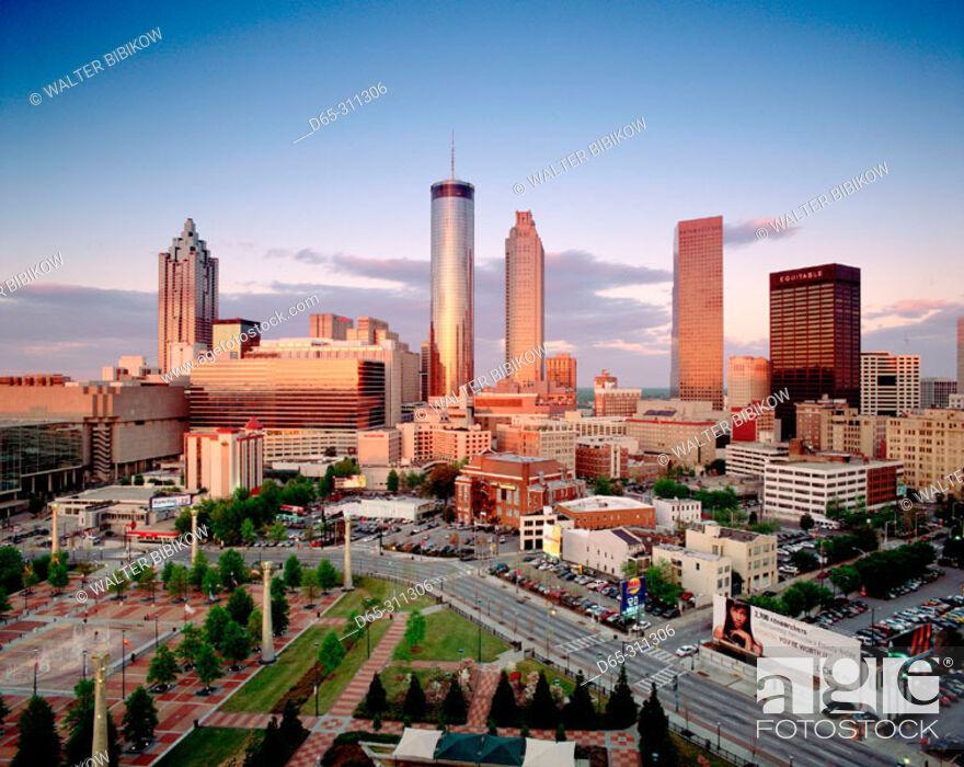 Stock Photo: Downtown skyline at sunset from CNN center. Atlanta. Georgia, USA.